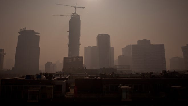 Severe pollution clouds the Beijing skyline on Saturday, where air quality index levels were so hazardous that they were classed as 'Beyond Index'.