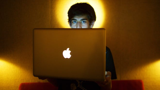 Internet activist Aaron Swartz poses for a photo in Miami Beach, Fla., on Jan. 30, 2009.