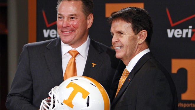 Butch Jones, left, was introduced as Tennessee's head coach by AD Dave Hart on Dec. 7.
