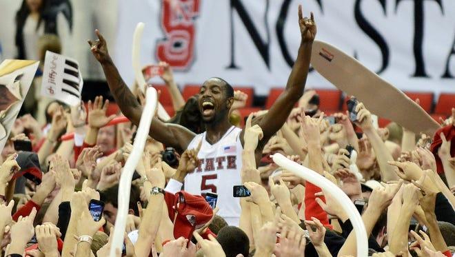 North Carolina State's C.J. Leslie is hoisted by fans after the Wolfpack upset No. 1 Duke. Leslie scored 25 points.