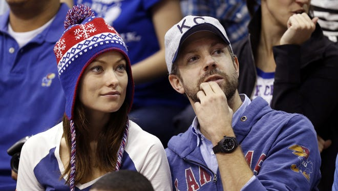 In this Dec. 29, 2012 file photo provided by Kansas University, Olivia Wilde and Jason Sudeikis watch Kansas play American in an NCAA college basketball game in Lawrence, Kan.