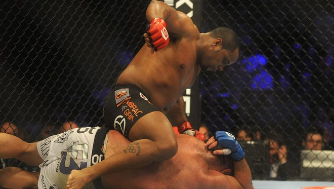 Daniel Comier, top, stopped Dion Staring  in their Strikeforce heavyweight bout Saturday.
