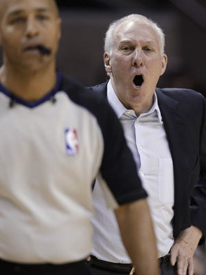 Spurs coach Gregg Popovich yells at a referee, leading to his ejection during Sunday's 106-88 win vs. the Timberwolves.