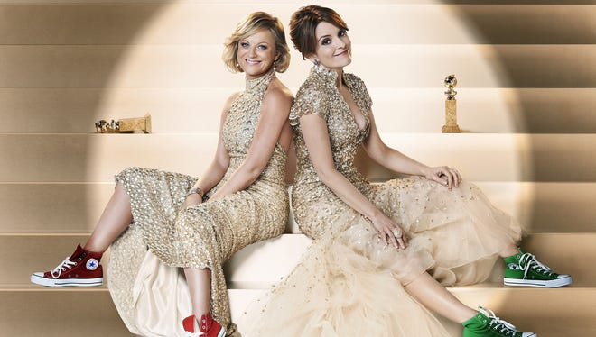 Amy Poehler, left, and Tina Fey are co-hosting the Golden Globes show tonight.