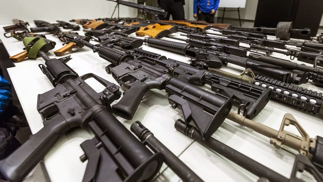 A variety of military-style semiautomatic rifles obtained during a buy back program are displayed at Los Angeles police headquarters last month.