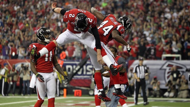 Atlanta Falcons quarterback Matt Ryan (2) and Jason Snelling (44) celebrate Snelling's touchdown against the Seattle Seahawks in the third quarter of the NFC divisional playoff game at the Georgia Dome.