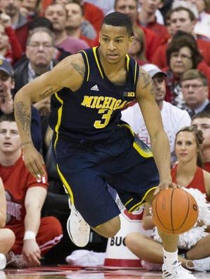 Trey Burke missed a key late three-pointer in Michigan's loss to Ohio State on Sunday.