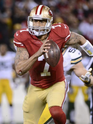 San Francisco 49ers quarterback Colin Kaepernick (7) sprints 20 yards to the end zone to score in the 1st quarter against Green Bay in NFC Divisional Playoff Game at Candlestick Park.