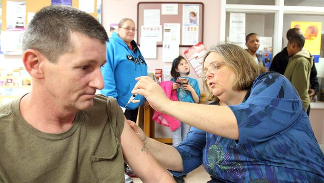 Ed Sessions receives a flu shot from registered nurse Natalie Sendler at a flu shot clinic Friday in Cape May Court House, N.J.