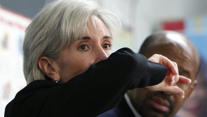 Health and Human Services Secretary Kathleen Sebelius demonstrates how to cough Sept. 8, 2009, in Philadelphia. Officials recommend coughing into an elbow instead of a hand to prevent the spread of germs.