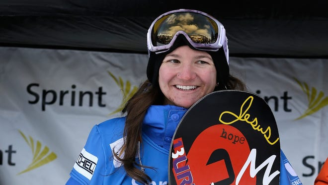 Kelly Clark stands on the podium after placing second in the FIS Snowboard World Cup halfpipe final at the US Grand Prix on Saturday  in Copper Mountain, Colo.