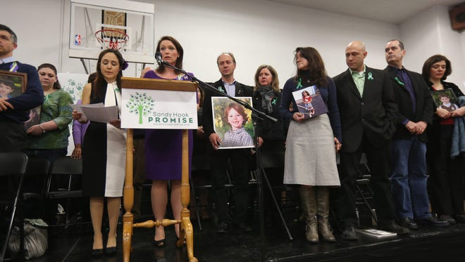 Parents of Sandy Hook Elementary School massacre victims speak during a news conference Monday in Newtown, Conn.