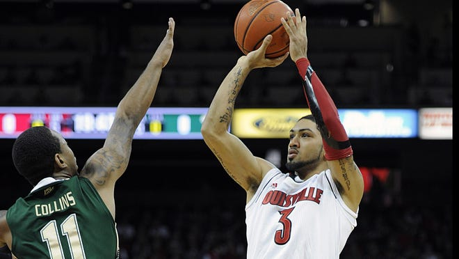 Senior point guard Peyton Siva, launching a jumper Saturday in the win against South Florida, leads the team in assists and is second in scoring.