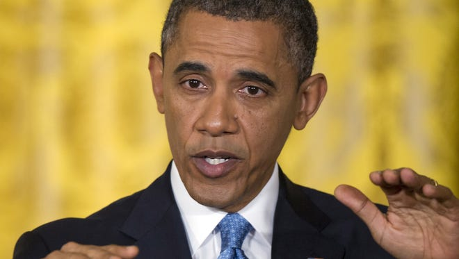 President Obama gestures during a news conference at the White House Jan. 14.