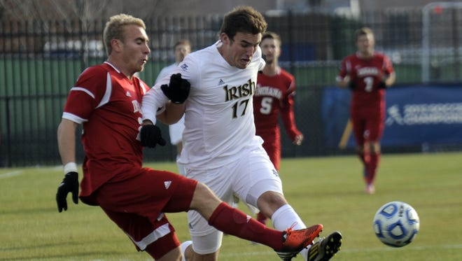 Notre Dame forward Ryan Finley (right) battles with Indiana defender Caleb Konstanski in first half action in the third round of the NCAA men's soccer championship held Nov. 25, 2012 in South Bend.