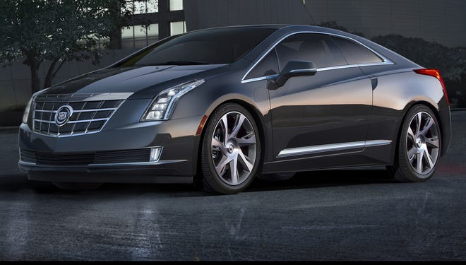 The 2014 Cadillac ELR luxury coupe cuts a dramatic, forward-leaning profile.