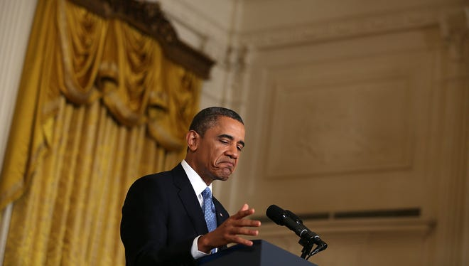 President Barack Obama pauses as he speaks during his final news conference of his first term at the East Room of the White House January 14, 2013 in Washington, DC. Obama spoke on the debt ceiling and deficit reduction during the news conference.