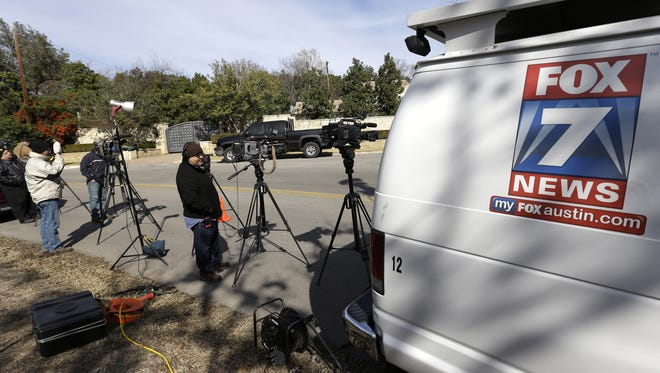 Media wait outside the Austin, Texas, home of cyclist Lance Armstrong on Monday as Oprah Winfrey conducts the interview in which the disgraced cyclist admits he used performance-enhancing drugs through his seven Tour de France titles.