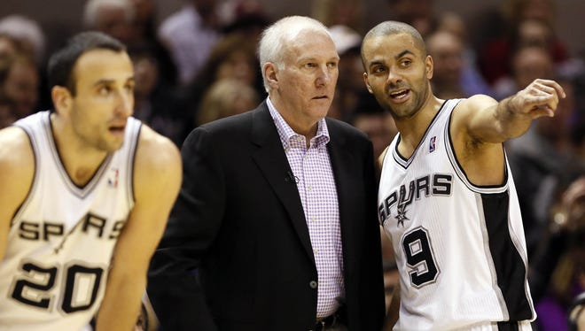 Spurs coach Gregg Popovich, center, sent home Tony Parker, right, Manu Ginobili, left, Danny Green and Tim Duncan from a road trip in November to get rest.
