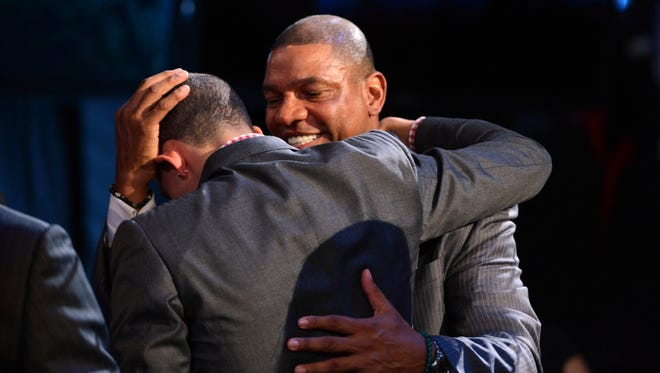 Austin Rivers, left, gets a hug from his father and Boston Celtics head coach Doc Rivers after being introduced as the number ten overall pick to the New Orleans Hornets during the 2012 NBA Draft.
