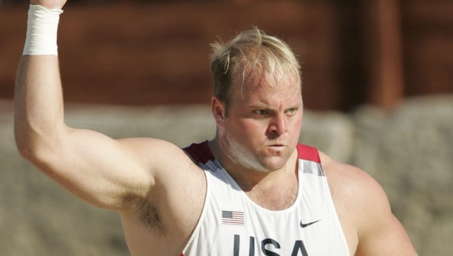 Adam Nelson gets ready to make a throw during the 2004 Athens Olympics men's shot final in Olympia, Greece.