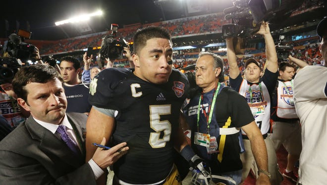 Notre Dame Fighting Irish linebacker Manti Te'o leaves the field after his team's defeat to the Alabama Crimson Tide in the 2013 BCS Championship game. Alabama won 42-14.