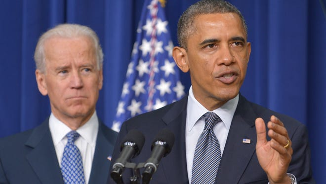 President Obama announces actions his administration would take to combat gun violence as Vice President Biden looks on.