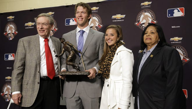 Kershaw, here with wife Ellen and Commissioner Bud Selig accepting baseball's Clemente Award, said his trips to Africa gave him a desire for less material extravagances.