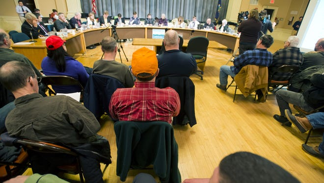 Gun owners crowd a Jan. 7, 2013, Burlington, Vt., City Council meeting at City Hall. Those opposed to the creation of an assault-weapons ban in the city dominated the public comment portion of the meeting, saying that a ban would do nothing to protect the public.