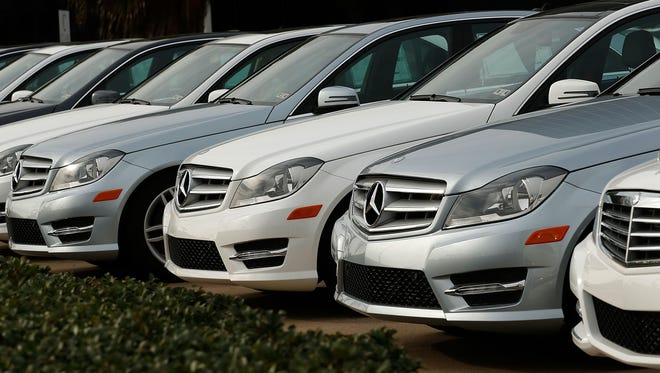 New luxury sedans are seen at the Mercedes-Benz of Houston Greenway dealership in Houston.