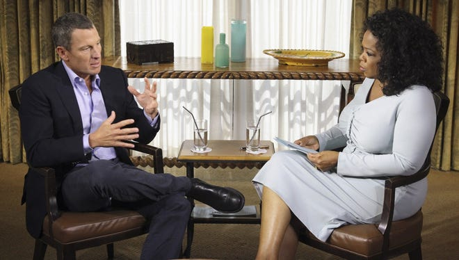 "In this Monday, Jan. 14, 2013, file photo provided by Harpo Studios Inc., talk show host Oprah Winfrey, right, interviews Lance Armstrong during taping for the show ""Oprah and Lance Armstrong: The Worldwide Exclusive"" in Austin, Texas. Armstrong confessed to using performance-enhancing drugs to win the Tour de France cycling during the interview that aired Thursday, Jan. 17, reversing more than a decade of denial."