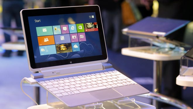 An Acer Iconia W510 tablet running on Windows 8 is on display at the Intel booth at the International Consumer Electronics Show.