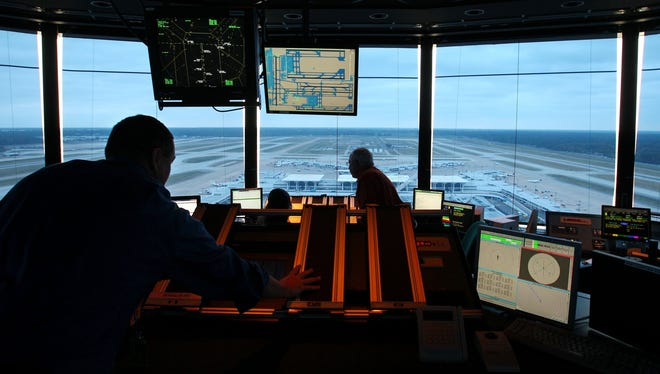 In this Oct. 19, 2011, photo, air traffic controllers guide planes in and out of the Memphis International Airport.