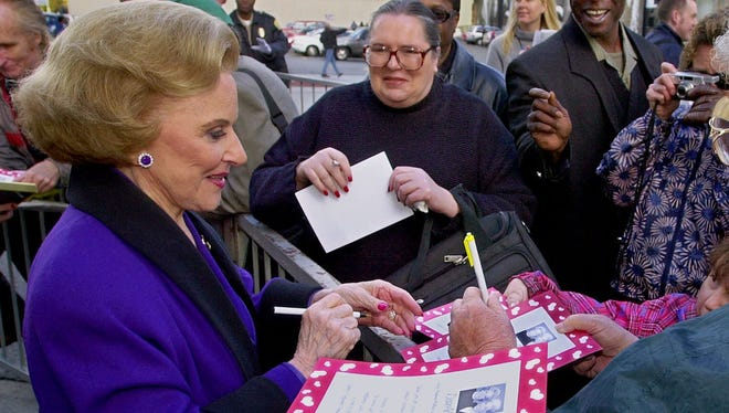 Pauline Friedman Phillips,  known to millions of readers as Abigail van Buren, signs autographs for  fans after the dedication of a 'Dear Abby' star on the Hollywood Walk of Fame in Los Angeles in 2001.