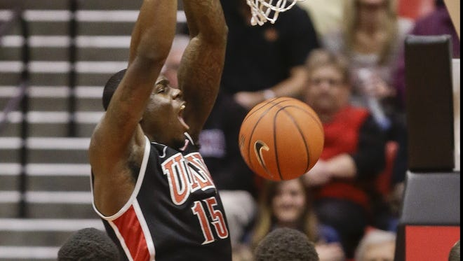 UNLV forward Anthony Bennett slams home a basket against San Diego State during his team's win.