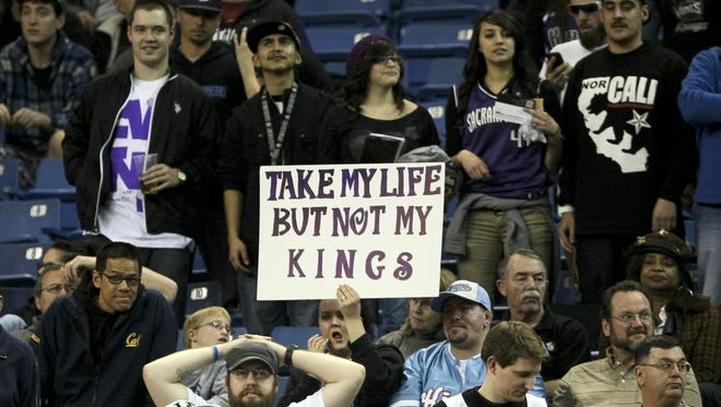 A Kings fan holds up a sign directed toward the Maloof family, which owns the team and has threatened to move it from Sacramento.