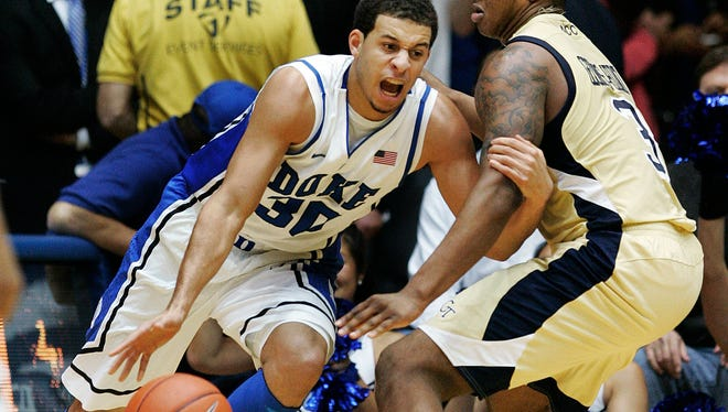 Duke Blue Devils guard Seth Curry drives against Georgia Tech Yellow Jackets guard/forward Marcus Georges-Hunt during the first half at Cameron Indoor Stadium.