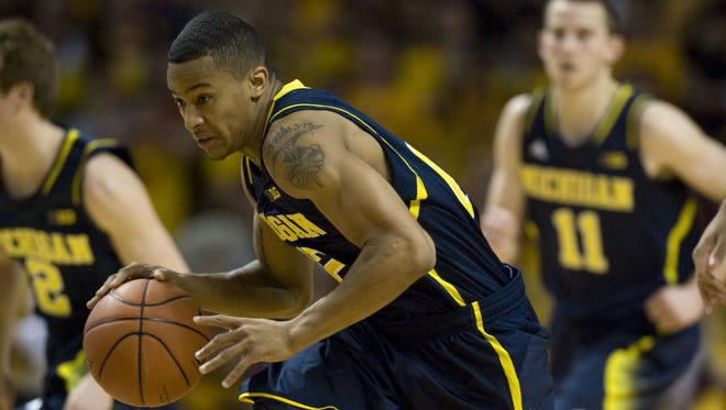 Michigan Wolverines guard Trey Burke breaks for the basket after a steal in the first half against the Minnesota Golden Gophers at Williams Arena.