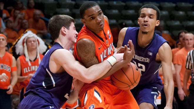 Illinois Fighting Illini guard Tracy Abrams is fouled by Northwestern Wildcats guard Dave Sobolewski during the second half at Assembly Hall.  Northwestern defeated Illinois 68-54.