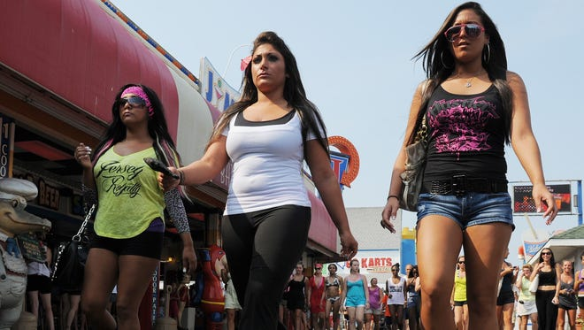 """Cast members of the MTV series """"The Jersey Shore"""" film Season 5 on July 29, 2011, in Seaside Heights, N.J. From left: Nicole """"Snooki"""" Polizzi, Deena Nicole Cortese and Sammi """"Sweetheart"""" Giancola."""