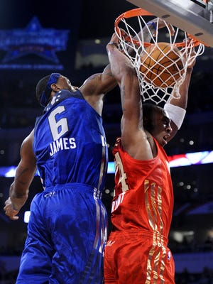 Kobe Bryant, right, throws down a dunk on LeBron James during the 2012 NBA All-Star Game. Bryant beat James to lead all vote-getters for the 2013 game.