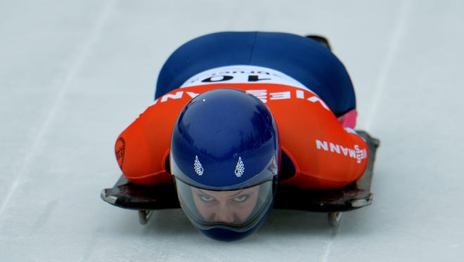 Noelle Pikus-Pace from the United States speeds down the track during her first run in the women's Skeleton World Cup race  in Innsbruck, Austria, Friday. The USA star finished second.