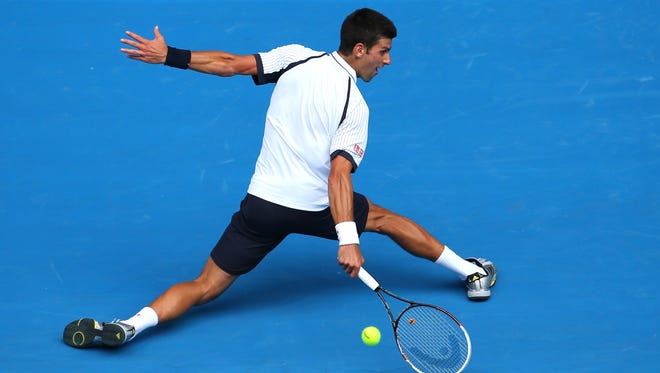 Novak Djokovic of Serbia chips a backhand on his way to a 6-4, 6-3, 7-5 third-round win against Radek Stepanek of the Czech Republic.