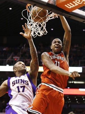 Bucks forward John Henson dunks over Suns forward P.J. Tucker during Thursday's 98-94 win.