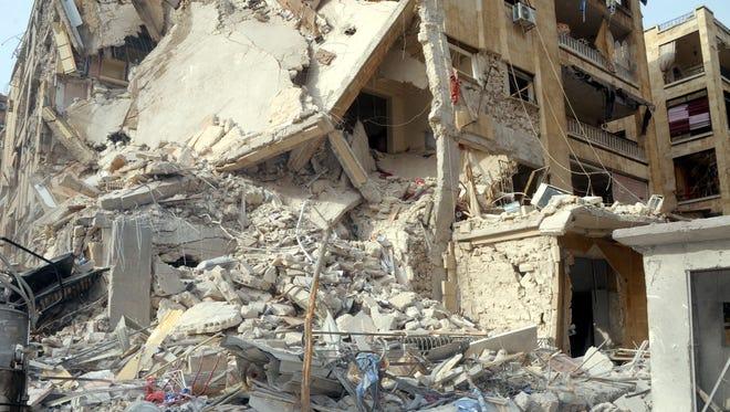A rocket damaged a building in Aleppo, Syria, on Friday.
