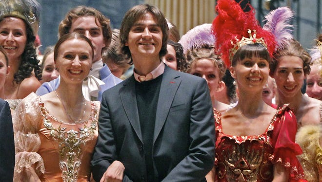 In this 2011 file photo, Sergei Filin poses with members of the Bolshoi Theater company involved in the Sleeping Beauty ballet, after a rehearsal.