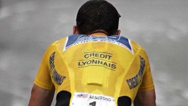A file picture taken on July 21, 2004 shows the yellow jersey of Lance Armstrong during the 16th stage of the 91st Tour de France cycling race, a time trial between Bourg d'Oisans and L'Alpe d'Huez.