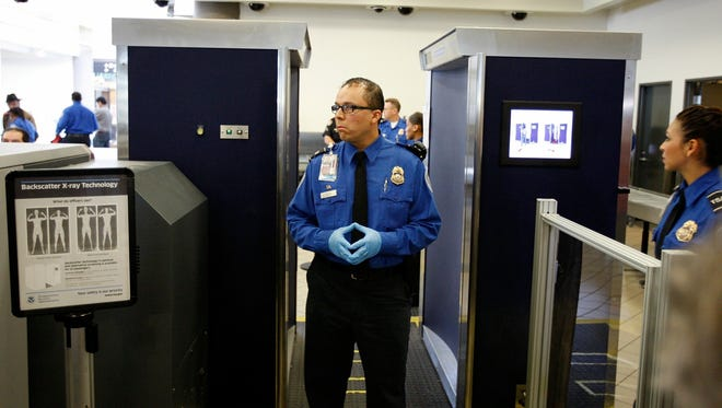 The Transportation Security Administration is dropping the full-body scanning machines that outraged many travelers. The maker of the machines, Rapiscan Systems, cannot produce software to eliminate the almost nude images that TSA personnel view and turn them into stick-like figures (2010 file photo from Los Angeles International Airport.)