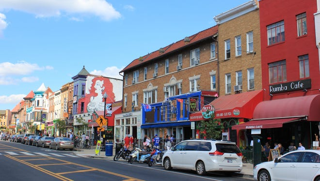 Adams Morgan's main thoroughfare is 18th St., with a high concentration of restaurants and bars, the most famous of which is Madam's Organ, pictured above. You can spot it by the giant mural of the redheaded woman painted on the building's side.