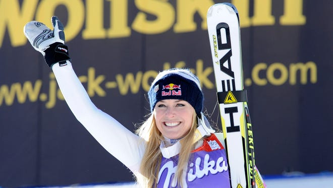 Lindsey Vonn, of the United States, celebrates at the finish area after winning an Alpine Ski World Cup women's downhill, in Cortina D'Ampezzo, Italy, Saturday.